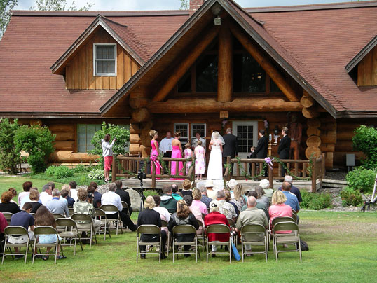 Wedding in front of White Pine Inn at Palmquist Farm